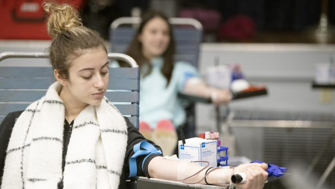 Isis Polanco of Newburgh, a Biology major (foreground) and Shannon Franchi of East Northport, a Nursing major, give blood at Mount Saint Mary College on Feb. 11.