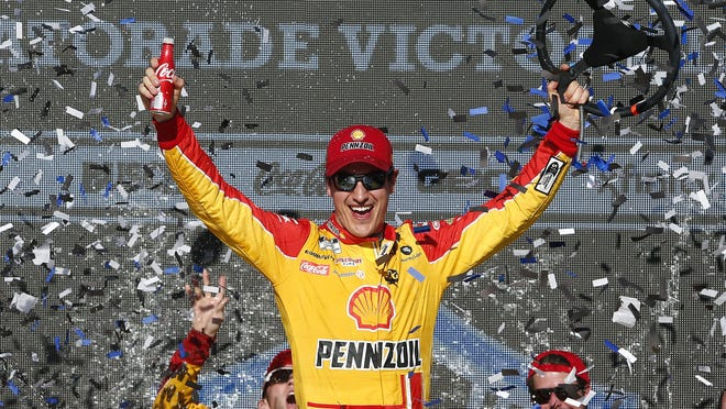 Joey Logano celebrates his 25th career Cup win after taking the checkered flag at Phoenix Raceway.