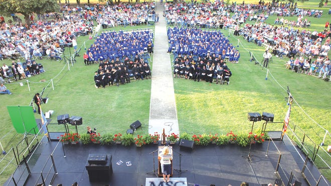 Murray State College commencement ceremony in 2014. The 2020 ceremony has been moved online due to coronavirus-related campus closure. A delay in delivery of caps and gowns has also postponed this semester's ceremony.