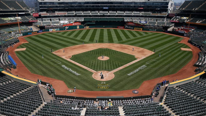 A general view of play between the Oakland Athletics and the Texas Rangers at Oakland-Alameda County Coliseum on August 06, 2020 in Oakland, California.