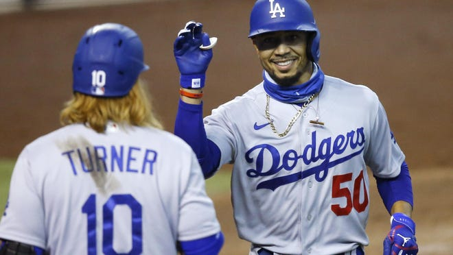 Los Angeles Dodgers outfielder Mookie Betts (50) celebrates his home run against the Arizona Diamondbacks with Justin Turner during the fifth inning of an Aug. 2 game in Phoenix.