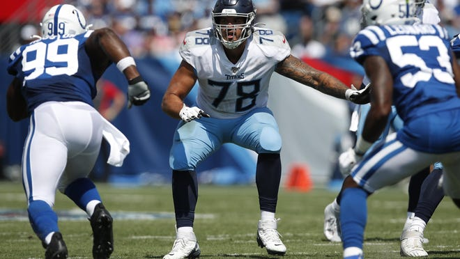 Tennessee Titans offensive tackle Jack Conklin set to block against the Indianapolis Colts/