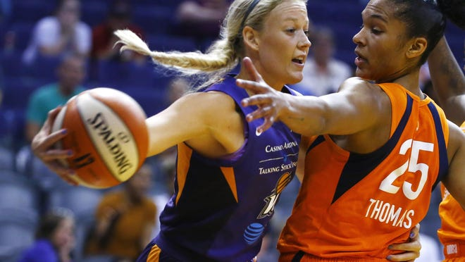 Phoenix Mercury guard Sophie Cunningham, left, gets a pass off around Connecticut Sun forward Alyssa Thomas (25) during a WNBA game Aug. 14, 2019, in Phoenix. The former Rock Bridge and Missouri star says she is ready to return to the court after her longest break from basketball that she can remember.