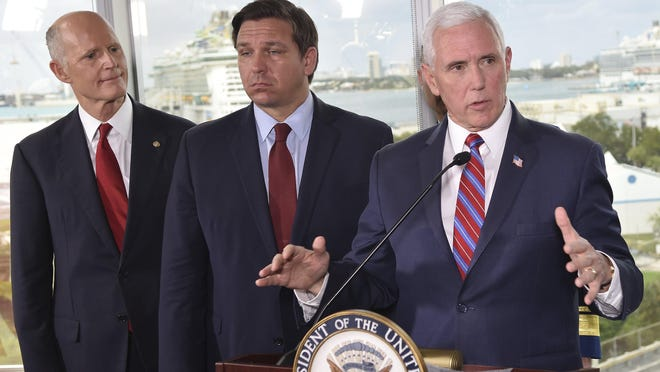 Vice President Mike Pence, right, along with Florida Sen. Rick Scott, left, and Gov. Ron DeSantis, center, speaks to the media after a meeting with cruise line company leaders to discuss the efforts to fight the spread of the COVID-19 coronavirus, at Port Everglades, Saturday March 7, 2020, in Fort Lauderdale, Fla.