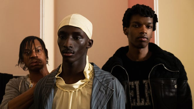 Designer Telfar Clemens, left, works backstage before his fashion show in Florence, Italy, in Janurary.