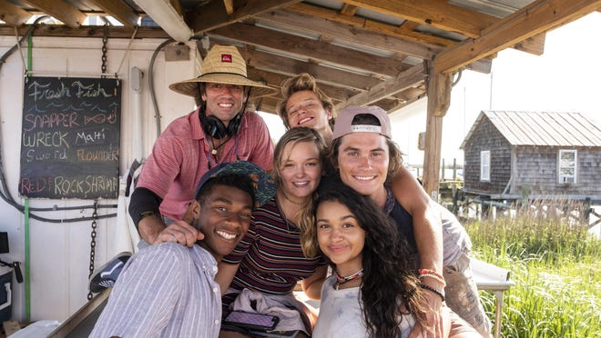 """Co-creator and director Jonas Pate (top left) joins the cast of Netflix's """"Outer Banks,"""" which has been renewed for a second season."""
