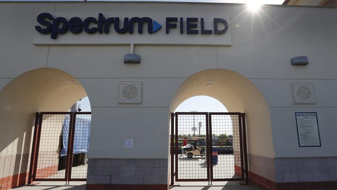 Gates to Spectrum Field, spring training baseball game home of the Philadelphia Phillies are locked, Friday, March 13, 2020, in Clearwater, Fla. Major League Baseball has delayed the start of its season by at least two weeks because of the coronavirus outbreak and suspended the rest of its spring training schedule.
