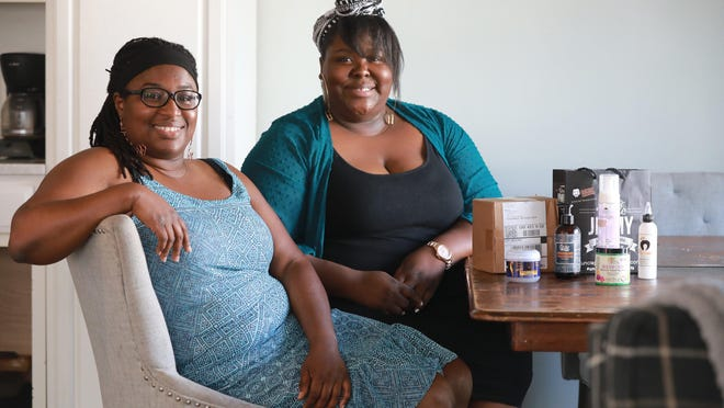 Sisters Dasha Tate, left, and Deanna Jones own the Regal Beauty hair supply business, which had a bricks-and-mortar store in Olde Towne East until the COVID-19 crisis forced them to close it and pivot to an online business.