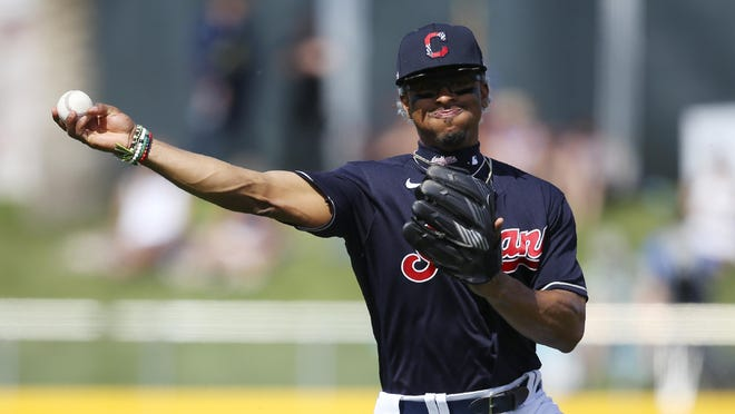 Indians shortstop Francisco Lindor throws to first base to get Los Angeles Dodgers' Terrance Gore out during the second inning of a spring training  game last month.