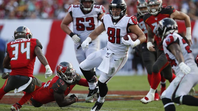 Atlanta Falcons tight end Austin Hooper runs the ball after a catch against the Tampa Bay Buccaneers during a game in December.