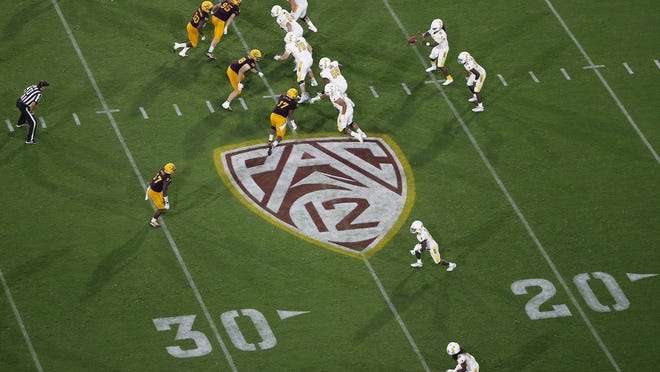PAC-12 logo during the second half of an NCAA college football game between Arizona State and Kent State, Thursday, Aug. 29, 2019, in Tempe, Ariz.