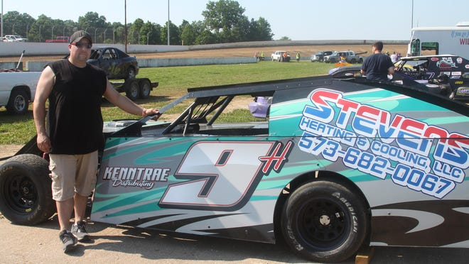 Chad Hickam of Centralia welcomed the Sunday reopening of Randolph County Raceway. He stands next to his vehicle that competes in the B-Modifieds class at the Moberly dirt track facility prior to the race in which he finished fifth among 22 drivers that qualified for the feature event.