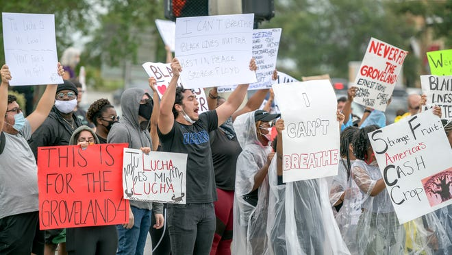 Protesters demonstrate at the intersection of State Road 50 and Hancock Road in Clermont on Wednesday, June 3, 2020.