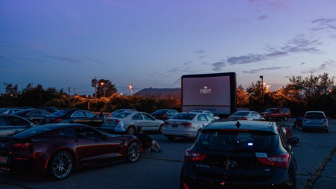 Cars gather for newportFILM's drive-in showing.