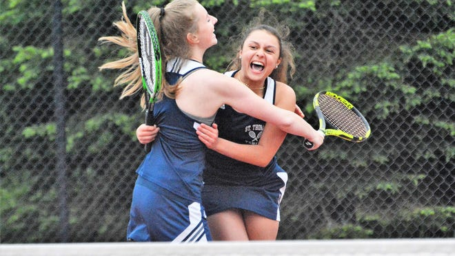 The St. Thomas duo of Kate Long, left, and Liv Fiorini celebrate their doubles win that clinched the 2019 Division III state championship for the Saints.