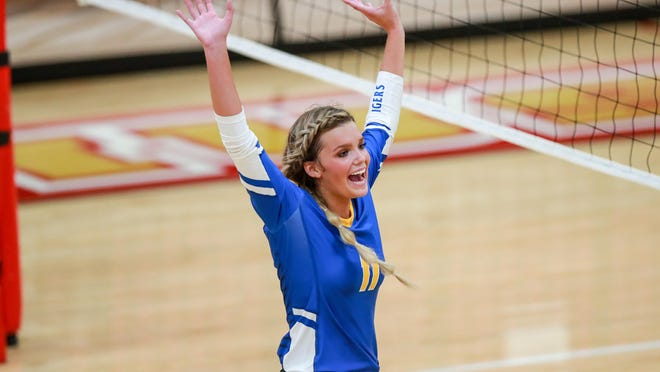Frenship's Gracie Harrison (11) celebrates winning a point against Caprock during a nondistrict match Tuesday at Coronado High School in Lubbock. The Tigers finished the day 2-0.
