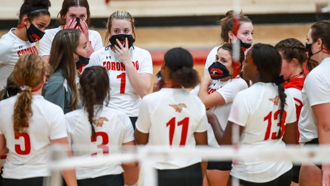 Coronado coach Casey Trout talks to her team during a timeout in nondistrict game Sept. 15 against Frenship at Coronado High School in Lubbock.The Lady Mustangs swept Palo Duro on Friday.