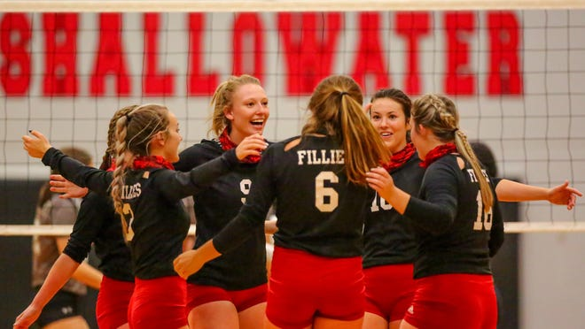 Shallowater celebrates winning a point against Lubbock High in a nondistrict match Tuesday in Shallowater, Texas.