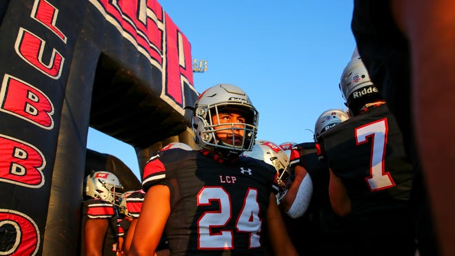 Lubbock-Cooper's Trey Atencio (24) prepares to take the field before a nondistrict game Sept. 25 against Caprock at Pirate Stadium in Woodrow, Texas.