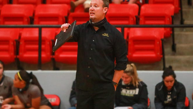 Lubbock High coach Matthew Leesman gives instructions during a nondistrict match Sept. 22 against Shallowater in Shallowater, Texas.