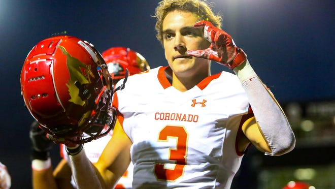 Coronado's Cory Ferreira (3) signals after scoring a touchdown against Lubbock-Cooper during a non-district game Friday at Pirates Stadium at First United Park in Woodrow.