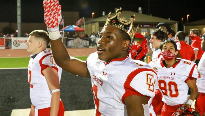 Coronado's Kaleb Pillow wears a crown and waves to the crowd after a nondistrict 28-0 road win against Lubbock-Cooper last Friday at Pirate Stadium in Woodrow.