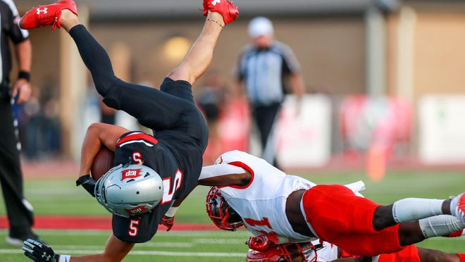 Coronado safety Ted Gilmore (11) upends Lubbock-Cooper wide receiver Jacob Politte (5) during Week Six football action on Oct. 2 at Pirate Stadium in Woodrow.