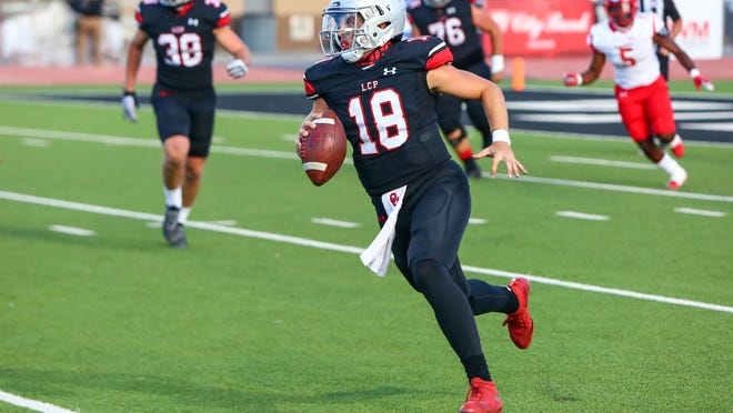 Lubbock-Cooper quarterback Cooper LaFebre (18) runs the ball against Coronado on Oct. 2, 2020, at Pirate Stadium in Woodrow.