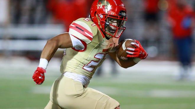 Coronado's Eli Martinez (27) runs for a touchdown against Odessa on Thursday, Oct. 8, 2020, at PlainsCapital Park-Lowrey Field in Lubbock, Texas.