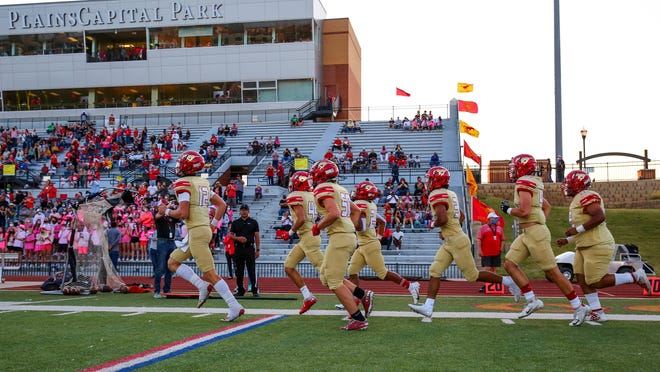 Coronado players take the field before the game against Odessa High on Oct. 8, 2020, at PlainsCapital Park-Lowrey Field in Lubbock, Texas.