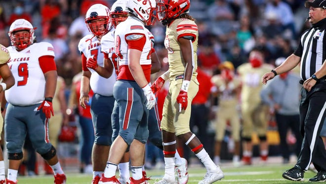 Odessa's Nathan Calvery (88) and Coronado's Izaiah Kelly (10) confront each other after a play on Thursday, Oct. 8, 2020, at PlainsCapital Park-Lowrey Field in Lubbock, Texas.