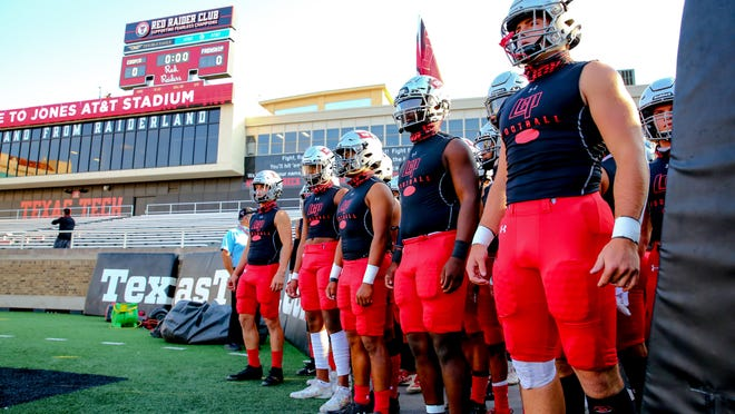 Cooper players prepare to take the field before the game against Frenship on Friday, Oct. 9, 2020, at Jones AT&T Stadium in Lubbock, Texas.