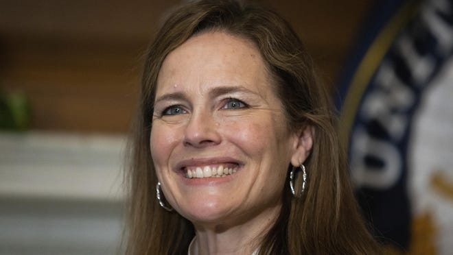 In this Oct. 1, 2020, photo, Supreme Court nominee Judge Amy Coney Barrett, meets with Sen. Roger Wicker, R-Miss., at the Capitol in Washington. Confirmation hearings begin Monday for President Donald Trump's Supreme Court nominee, Amy Coney Barrett. If confirmed, the 48-year-old appeals court judge would fill the seat of liberal Justice Ruth Bader Ginsburg, who died last month.