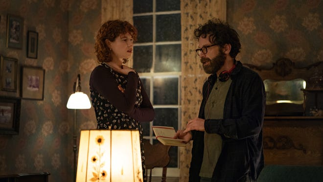 "Charlie Kaufman gives Jessie Buckley an idea for her character on the set of ""I'm Thinking of Ending Things."""