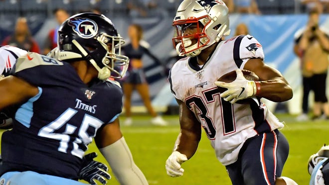 New England Patriots running back Damien Harris (37) rushes against Tennessee Titans outside linebacker James Folson (48) during the second half at Nissan Stadium on Aug. 27, 2019.