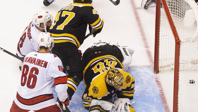 Boston Bruins goaltender Tuukka Rask (right) watches the puck cross the line on what would be ruled no goal due to goalie interference during third period of playoff action in Toronto on Thursday. Two days later, Rask said he was opting out of the NHL playoffs.