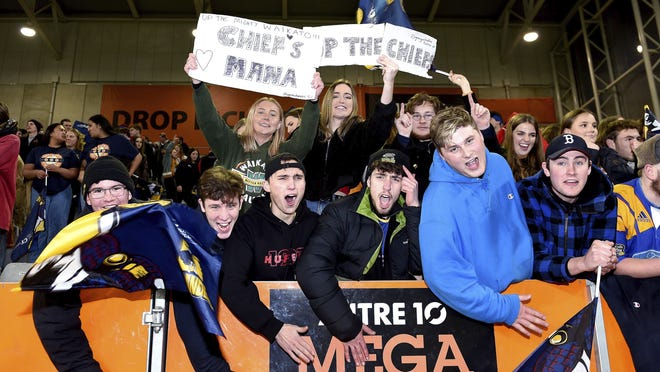 Spectators cheer during the Super Rugby Aotearoa rugby game between the Highlanders and Chiefs in Dunedin, New Zealand, on June 13, 2020. Super Rugby Aotearoa is the first major rugby union tournament to resume since the COVID-19 outbreak and one of the first major sports events in the world at which there will be no limitation on crowd size.