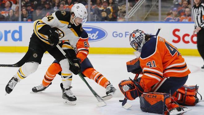 Feb 19, 2020; Edmonton, Alberta, CAN; Edmonton Oilers goaltender Mike Smith (41) makes a save on Boston Bruins forward Jake DeBrusk (74) during the second period at Rogers Place. Perry Nelson-USA TODAY Sports
