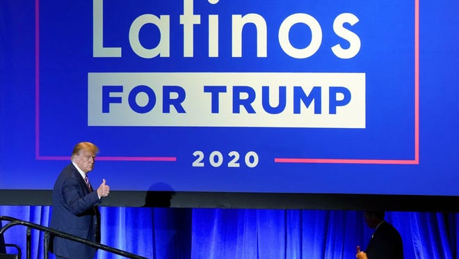 President Donald Trump give a thumbs up to the cheering crowd after a Latinos for Trump Coalition roundtable in Phoenix on Sept.14.