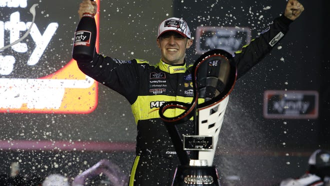 Austin Cindric celebrates in Victory Lane after winning the season championship and a NASCAR Xfinity Series race at Phoenix Raceway, Saturday in Avondale, Ariz.