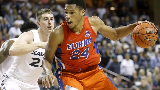 Florida's Kerry Blackshear Jr., drives on Xavier's Jason Carter in the second half of a game during the finals of the Charleston Classic on Sunday, Nov. 24, 2019, in Charleston, SC.