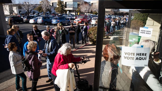 Voters in Reno, Nevada, wait in line on Tuesday, Feb. 18, 2020, to vote early in the Nevada caucuses.