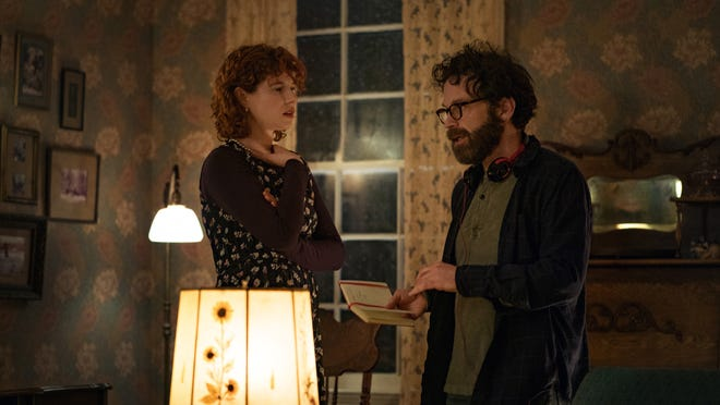 """Charlie Kaufman gives Jessie Buckley an idea for her character on the set of """"I'm Thinking of Ending Things."""""""