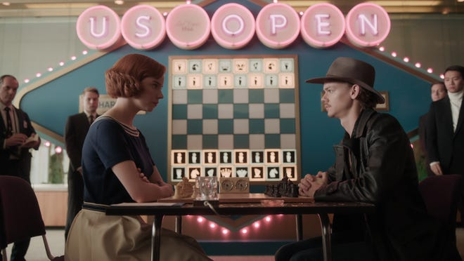 Beth (Anya Taylor-Joy) and Benny (Thomas Brodie-Sangstser) both have checkmate in their minds.