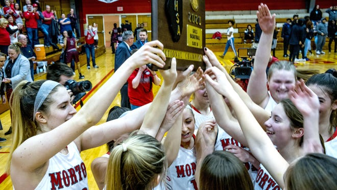 Morton Potters celebrate their IHSA Class 3A trophy after a 63-43 win Thursday, February 27, 2020 over Peoria High Lions.