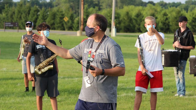 Sturgis High School Band Director Jim Whitehead gives instructions to the band students Monday.