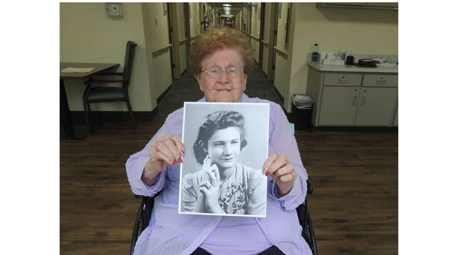 Theresa Miller holds a portrait of herself at sweet 16 at the Wellspring Lutheran Services where she celebrated her 95th birthday Sunday. She has lived at the nursing home since May, 2018.