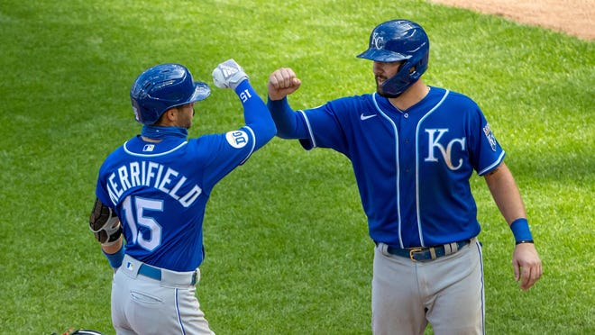 Kansas City Royals outfielder Whit Merrifield (15) is greeted by teammate Cam Gallagher (36) after belting a three-run homer in the second game of Saturday's doubleheader at Target Field.