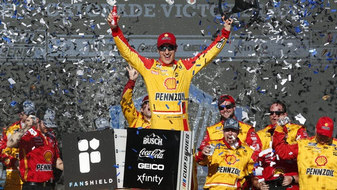 Joey Logano celebrates in Victory Lane after winning a NASCAR Cup Series auto race at Phoenix Raceway in March.