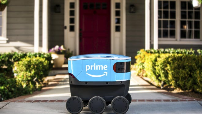 FILE - This undated photo provided by Amazon shows a self-driving delivery robot that Amazon is calling Scout.  Amazon is expanding the use of its self-driving delivery robots to a second state.The online shopping giant says the six-wheeled robots, about the size of a Labrador, will start delivering packages to customers in Irvine, Calif. Amazon.com Inc. has been testing them in a Seattle suburb since the beginning of the year.